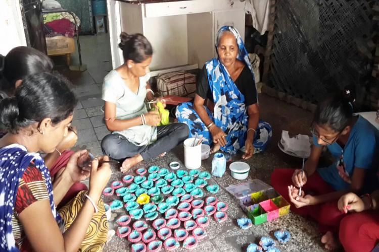 Impact Guru - Making hand painted diyas for marginalized families