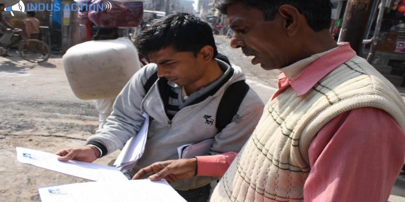 Impact Guru - Indus Action volunteers in action